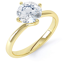 An exquisite single stone diamond engagement ring in 18ct yellow gold