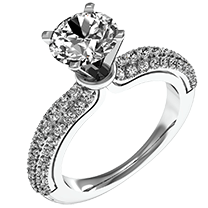 A beautiful round brilliant cut engagement ring with diamond set shoulders in 18ct white gold