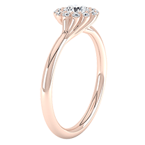 A sensational cluster engagement ring with a dazzling round brilliant cut diamond in 18ct rose gold