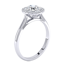An exquisite cluster engagement ring with a breathtaking round brilliant cut diamond in 18ct white gold
