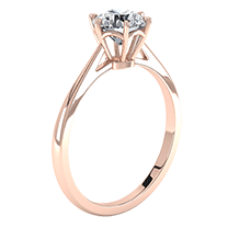 A fabulous single stone engagement ring in 18ct rose gold with a shiny round brilliant cut diamond in a six claw setting