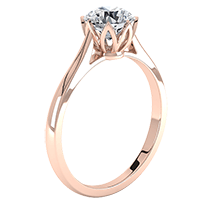 A contemporary single stone round brilliant cut engagement ring in 18ct rose gold