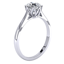 A contemporary single stone round brilliant cut engagement ring in 18ct white gold