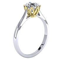 A contemporary single stone round brilliant cut engagement ring in 18ct white and yellow gold