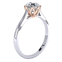 A contemporary single stone round brilliant cut engagement ring in 18ct white and rose gold